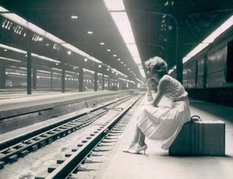photo-chicago-union-station-platform-woman-sitting-on-suitcase-b-and-w-1960